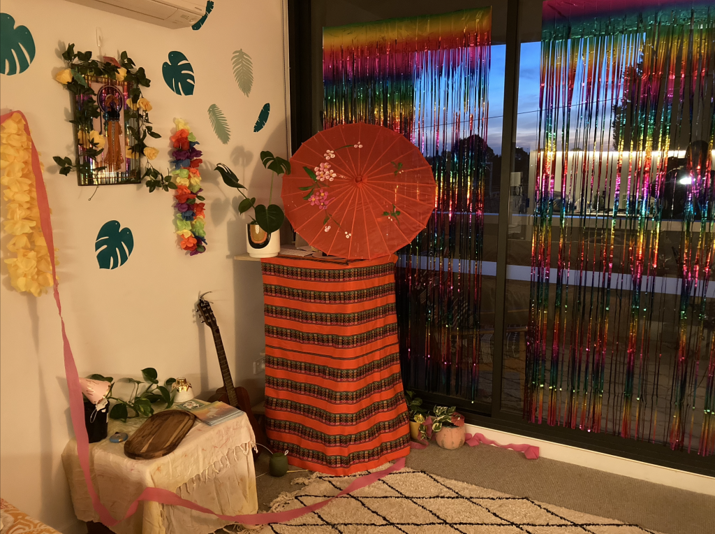 A room decorated with streamers and party accessories.