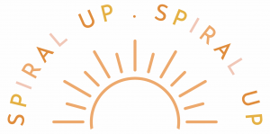 Orange, yellow and pink sun with the words 'spiral up' twice at the top of the logo.